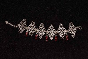 #104 Filigree Bracelet With Siam Red Swarovski Crystals.
