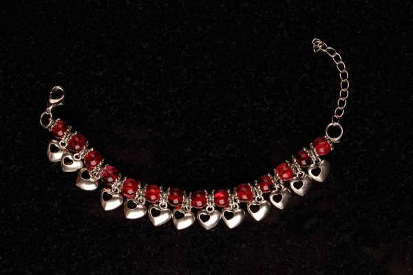 #155 Red Glass Bead and Hearts Bracelet.