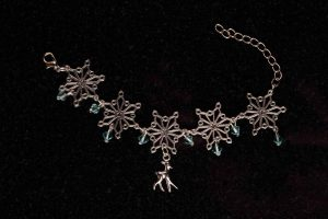 #177  Snow Flake, Swarovski Crystals and Reindeer Bracelet