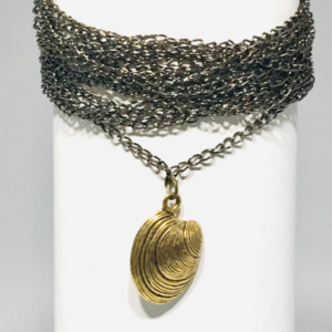 Multi Strand Bracelet With Antique Gold Shell