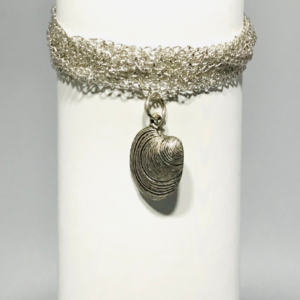 Multi Strand Bracelet With Antique Silver Shell