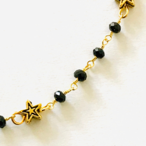 Gold Star And Rosary Chain Bracelet.
